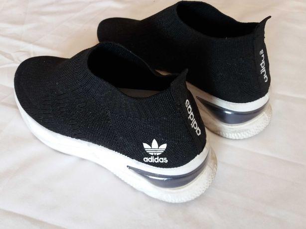 Ténis marca Adidas/mochilas