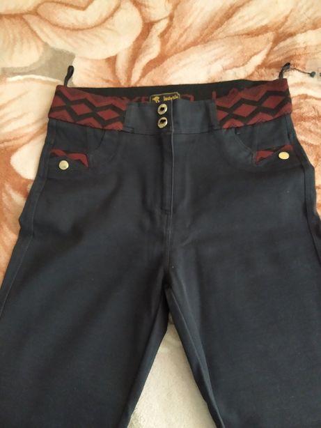 Продам  женские брюки .