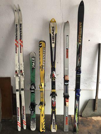 Zestaw narciarski, narty, kijki oraz obuwie narciarskie