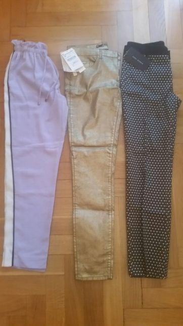 Nowe spodnie Zara Woman River Island 34