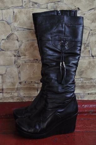 Женские кожаные зимние сапоги на платформе
