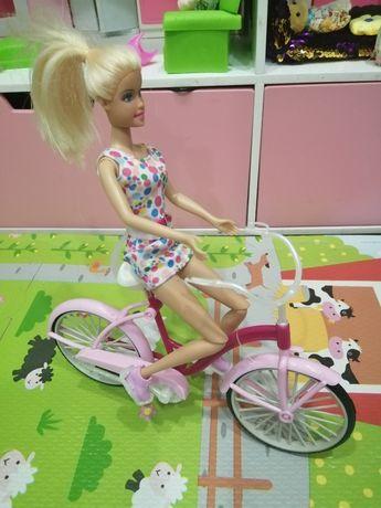 Кукла барби на велосипеде