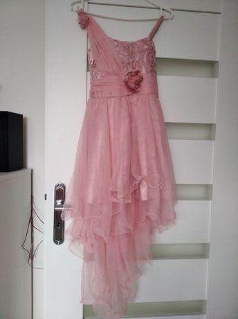 Sprzedam sukienkę róż.134-140