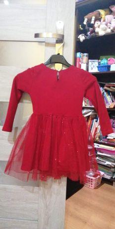 Sprzedam sukienkę rozmiar 104/110