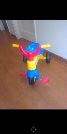 p. ex. Triciclo baby 1/2 anos