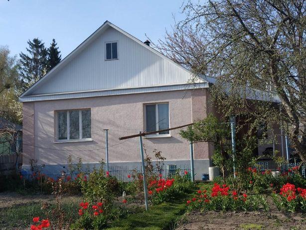 Будинок з земельною ділянкою