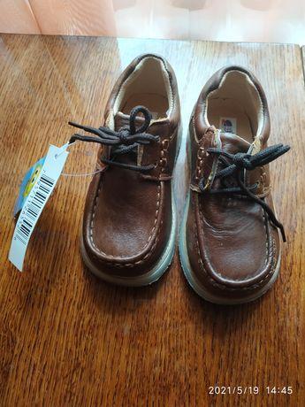 Продам недорого нові шкіряні туфлі на хлопчика .