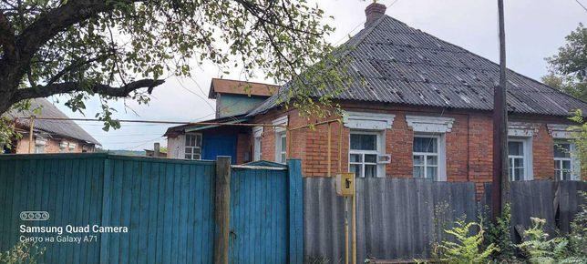 Дом с постройками, огородом, гаражом