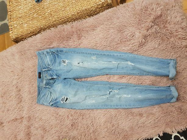 Spodnie jeans dziury przetarte r.36