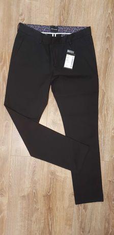 Nowe spodnie męskie chinosy Wólczanka