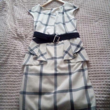 Elegancka sukienka baskinka z paskiem