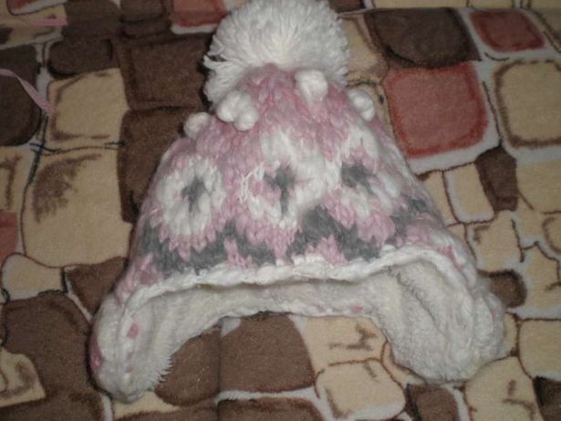 Продам зимнюю шапку на девочку фирмы Next