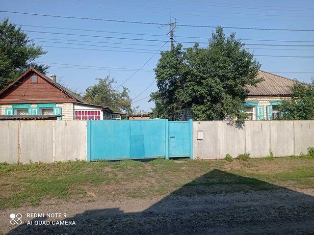 Продам в центе Оскола усадьбу 14 соток состоящую из двух домов, гаража