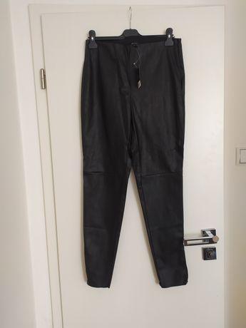 Czarne woskowane spodnie