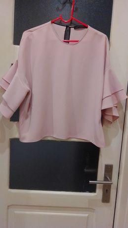 Blusa de meia manga cor de rosa com folhos