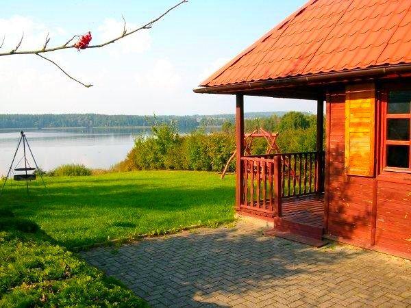 Domek całoroczny nad jeziorem z linią brzegową Mazury Rybical -Marysia
