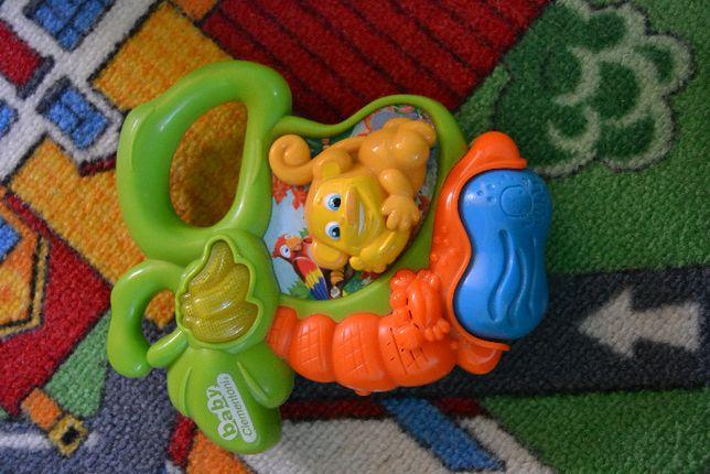grzechotka clementoni małpka