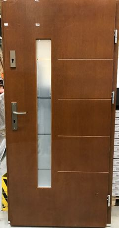 OBI Drzwi zewn.Domino złoty dąb 90P przecenione z 2079 na 1399zł