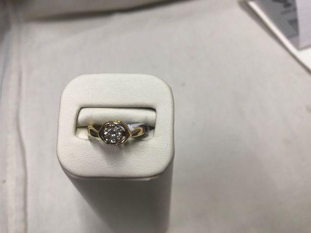 Złoty pierścionek z brylantem 0,5 ct, waga 4,4 g