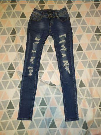 Spodnie rurki dżinsowe jeansowe z dziurami xs 34 s 36