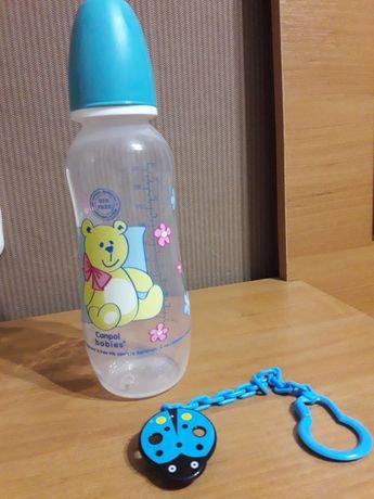 Детская бутылочка и цепочка для соски
