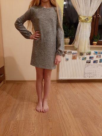 Sukienka z bufiastymi rękawami Reserved 140
