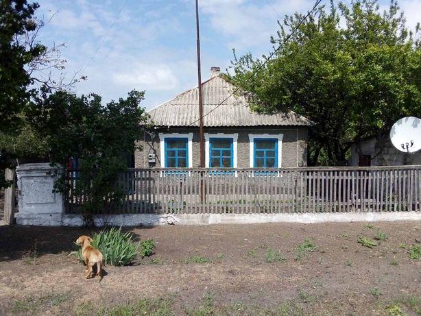 Обменяю жилой дом с земельным участком в селе на жильё в Мариуполе