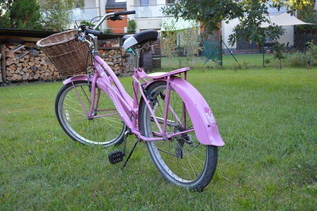 Rower damski Merida, różowy, z koszem wiklinowym