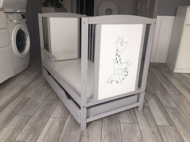 Szare łóżeczko dla niemowląt
