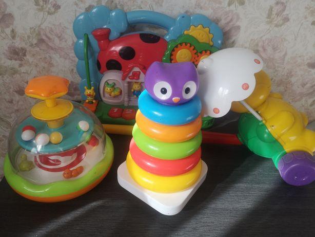 Игрушки детские интерактивные развивающие . Пирамидка юла толкалка
