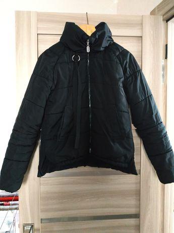 Жіноча куртка.   .