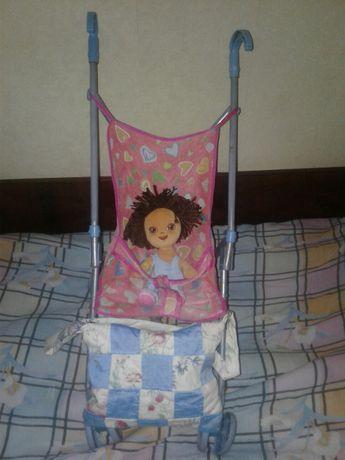 Продам куклу с коляской и одеждой