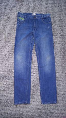 Spodnie dżinsy Reserved