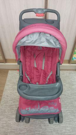 Дитячий рожевий візок