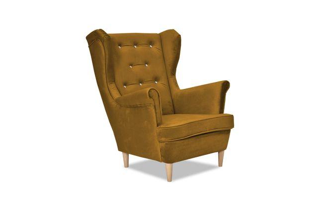 Fotel Uszak Diana odcień brudnego złota glamour salon sypialnia