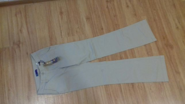 AJC Nowe beżowe spodnie rozm 32
