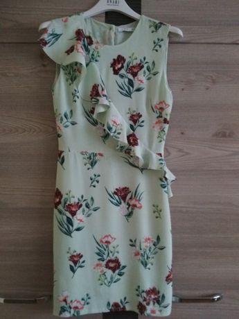 Seledynowa sukienka bez rękawów z falbaną Mango XS