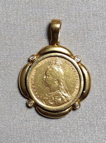 Medalha com libra em ouro com brilhantes