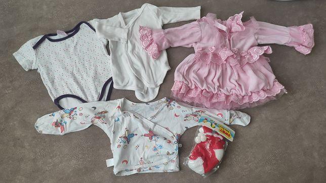 Детские вещи на новорожденных