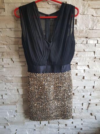 Czarno złota sukienka.