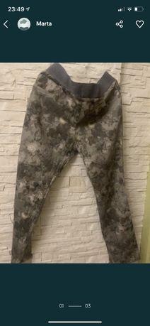 Spodnie  w kwiaty 25zl
