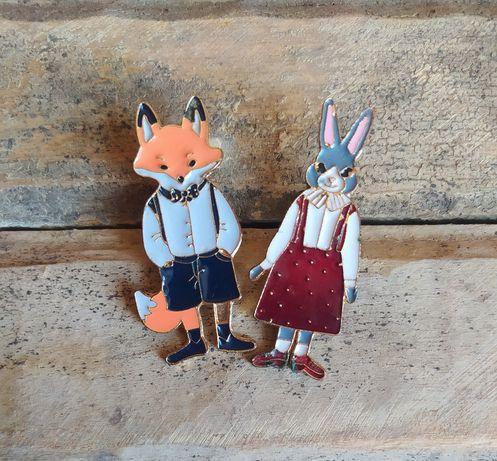 Значки лисеня та кролик