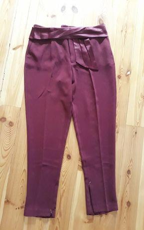 Eleganckie spodnie z paskiem  kieszenie 40