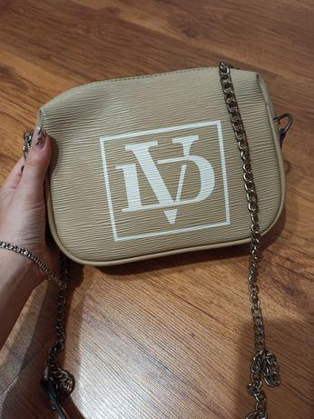 Жіноча сумочка з ремішком