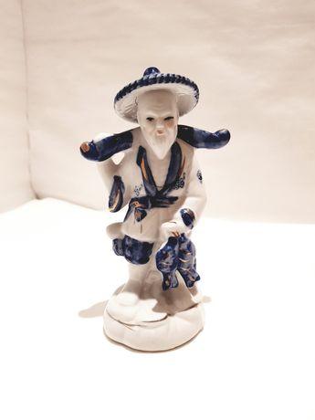 Unikatowa sygnowana figurka Rybaka porcelana