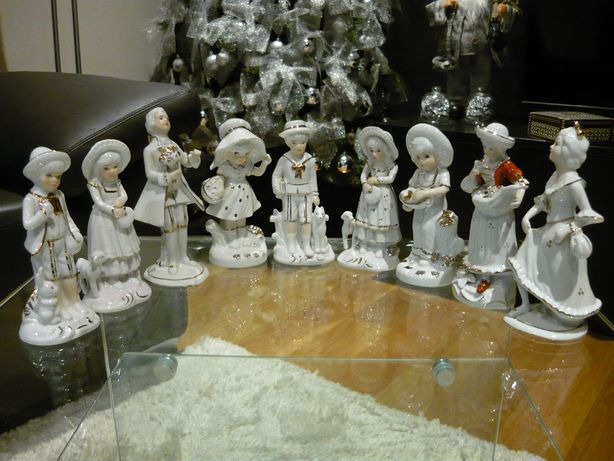 Coleção de figuras em loiça com dourado