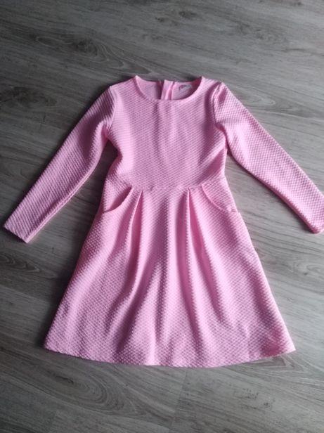 Pastelowa sukienka stan idealny r. 134
