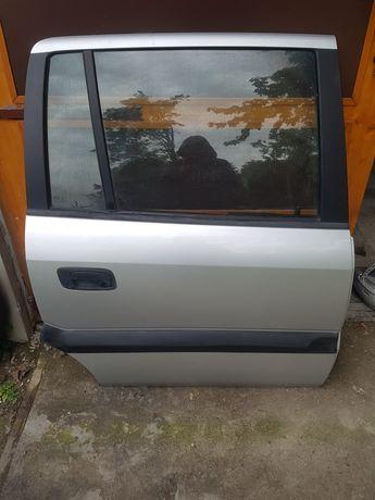 Drzwi Opel Zafira A Prawy Tył Srebrne Ładne