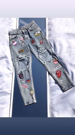 Spodnie z dziurami z naszywkami missdenim