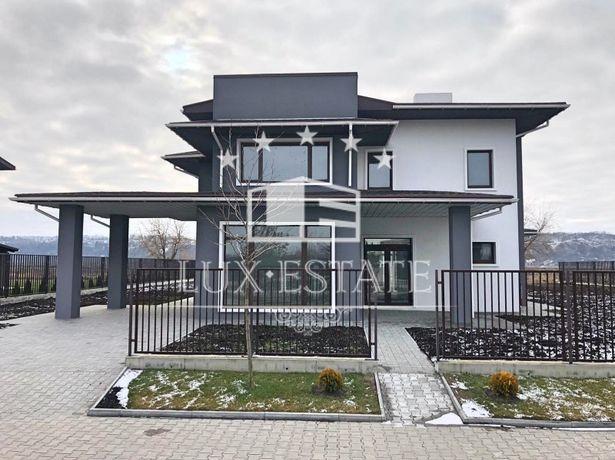 Продам новый дом в современном архитектурном решении Романков